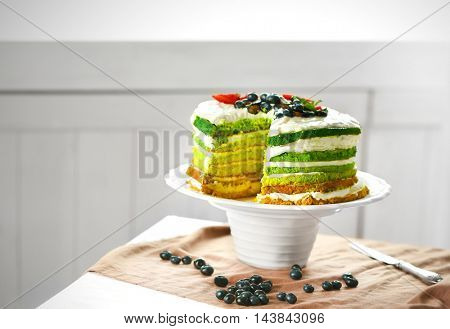 Delicious cake with berries on stand