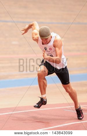 VIENNA, AUSTRIA - JANUARY 31, 2015: Thomas Kain (#508 Austria) competes in the men's 200m event during an indoor track and field event.
