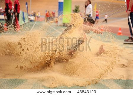 VIENNA, AUSTRIA - JANUARY 31, 2015: Alper Kulaksiz (#280 Turkey) competes in the men's long jump event during an indoor track and field event.