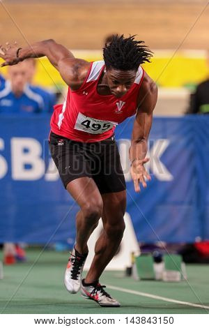 VIENNA, AUSTRIA - JANUARY 31, 2015: Sam Gordon (#495 Great Britain) competes in the men's 60m event during an indoor track and field event.