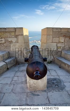 Protecting cannon on the top of Alicante castle Santa Barbara, summer Spain