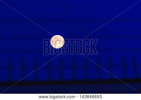 Full Moon Behind Bars