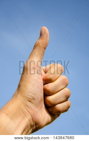 asia men thumbs up blue sky background