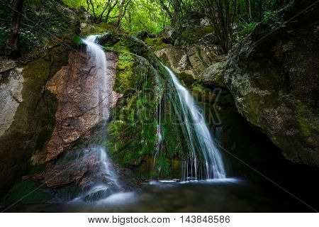 Waterfall in a forest of North Italy