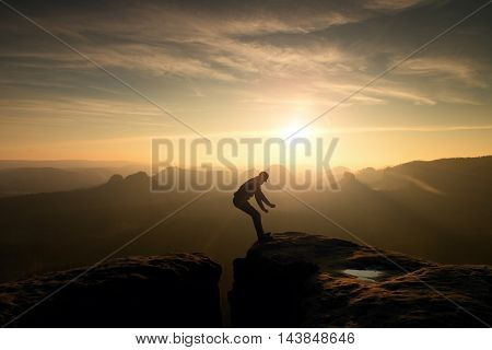 Crazy Hiker Jump. Wonderful Daybreak In Rocky Mountains,