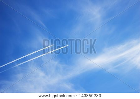 Two planes flying in parallel leaving behind a white trail.