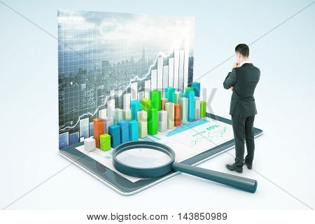 Thinking businessman looking at tablet with voluminous business chart and magnifying glass. City background. Market analysis concept. 3D Rendering