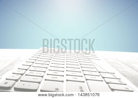 Side view and close up of white keyboard placed on light wooden desktop. Blue background. 3D Rendering