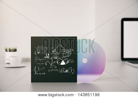 Workplace with business drawing on CD cover. 3D Rendering