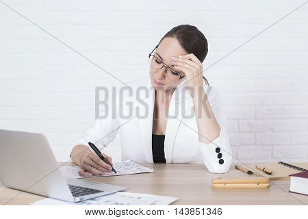 Pensive Businesswoman Doing Paperwork