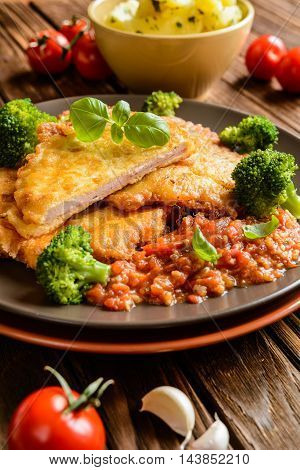 Pork Piccata With Tomato Sauce And Steamed Broccoli And Boiled Potatoes