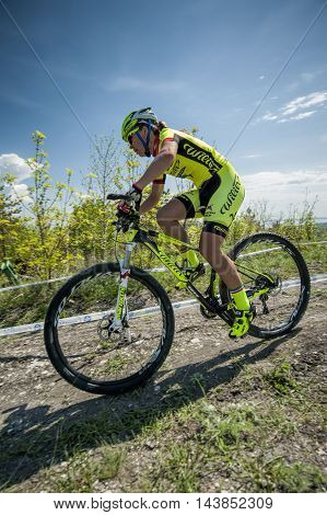 KHVALYNSK - MAY 7, 2016: Female cyclist rides fast at XCE eliminator track championship 'Match of Russian cities' on May 7, 2016 in Khvalynsk, Saratov region, Russia.