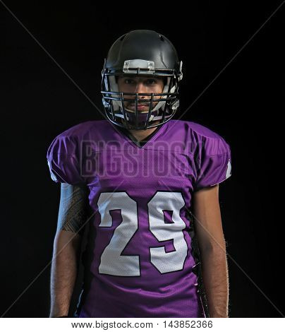 American football player on black background.