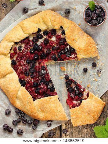 Summer pie with fresh berries of black raspberries Cumberland