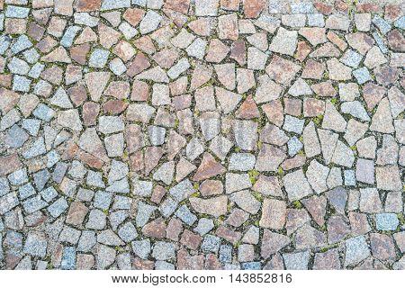 Uneven stone tiles background texture