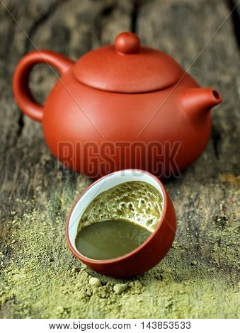 Green tea powder matcha on a wooden table