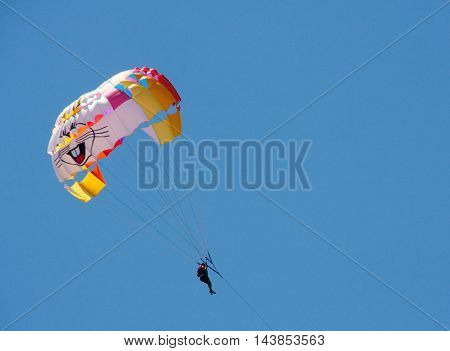 tourist attraction parasailing on blue sky background.