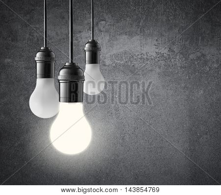 three hanging light bulbs on grunge wall