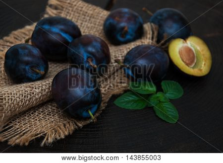 Fresh Plums With Green Leaves