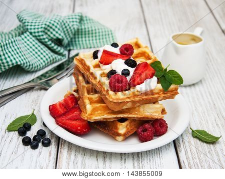 Waffles With Strawberries,  Blueberry And Sauce