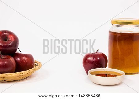 Pile Of Apples And Red Apple And Jar Of Honey Bowl Of Honey Isolated On A White Background