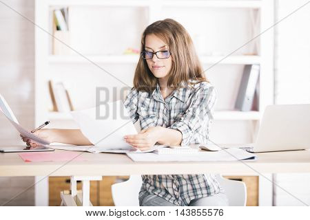 Portrait Of Casual Woman Doing Paperwork