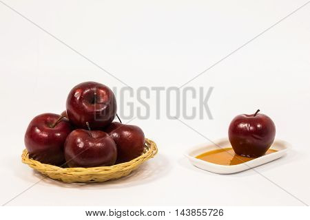 Pile Of Red Apples And Red Apple On White Plate With Honey Isolated On A White Background