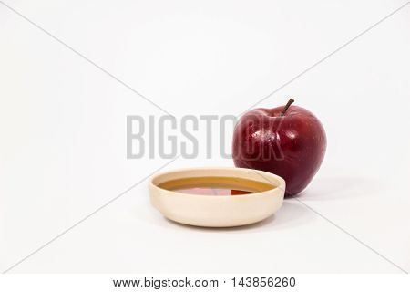 Red Apple And Bowl Of Honey Isolated On A White Background
