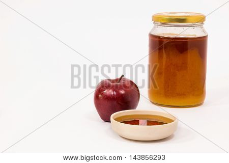 Red Apple And Jar Of Honey Bowl Of Honey Isolated On A White Background