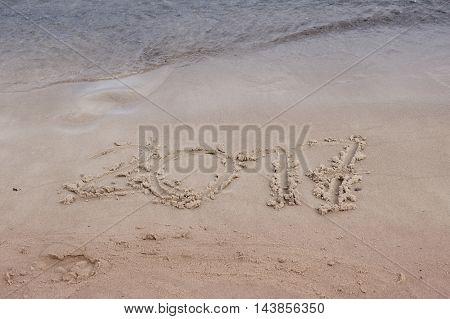 Sea ocean sand Inscription 2017, sign in sand