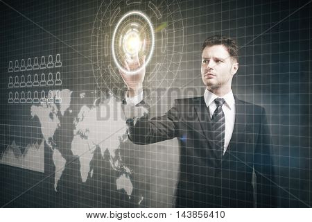 Frowny businessman pressing virtual buttons on digital interface with abstract map. Grey background