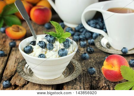 Cottage cheese with berries fresh berries and fruits for breakfast. Delicious healthy and dietary food concept selective focus