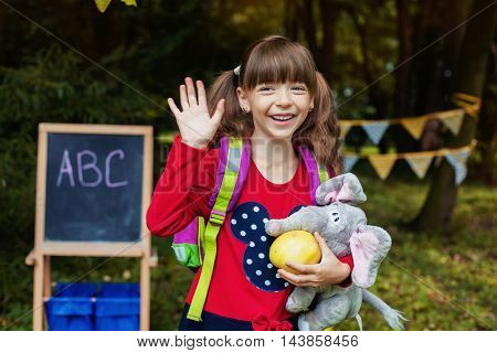 beautiful girl smiling schoolgirl. The concept of school and education