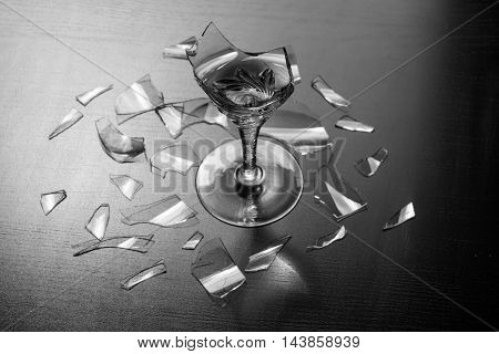 Elegant broken wine glass glass shards around reflect sunlight