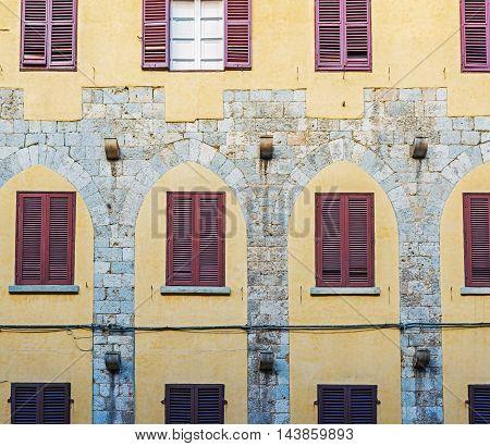 Antique Facade In A Pisa Street. Italy.