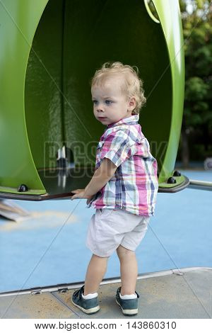 Curly Toddler At Playground