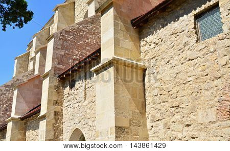 Exterior stone walls of an old church architectural details.