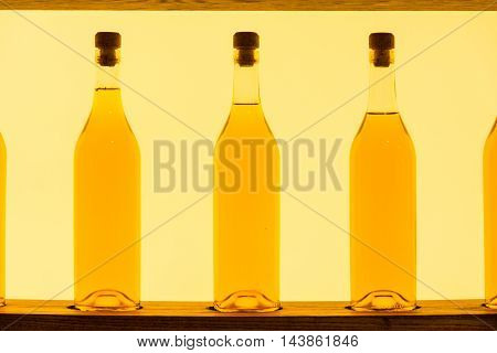Abstract Yellow Clear Glass Bottles Shelf Backlit