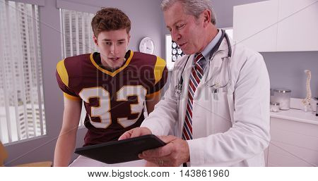 College Football Athlete Receiving Good News From Doctor