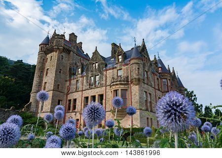 Dreamy Belfast Castle on Beautiful Flowers in Garden Perspective One