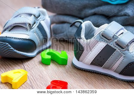 baby winter clothing concept autumn sneakers caps toys. how to dress baby winter.