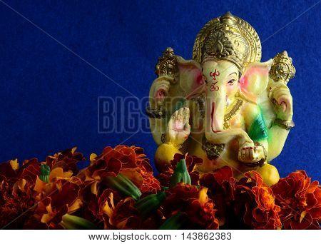 Hindu God Ganesha. Ganesha Idol on blue Background.