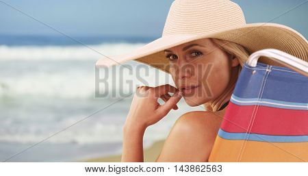 Closeup Of Woman Sitting By The Beach
