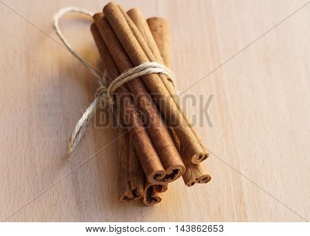 cinnamon roped and presented with a linen rope