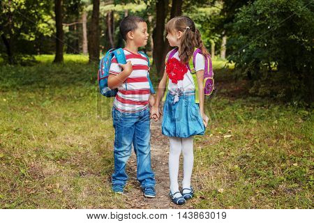 little schoolchild holding hands together and go to school