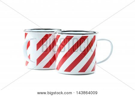 Striped cup isolated on a white, close up