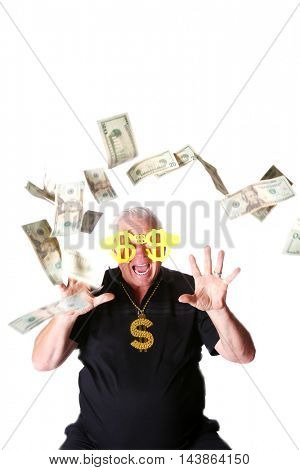 Money From Heaven. A business man has money floating down upon him from above. Isolated on white