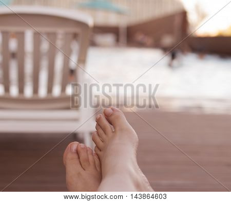 Woman Feet On Chair At The Pool