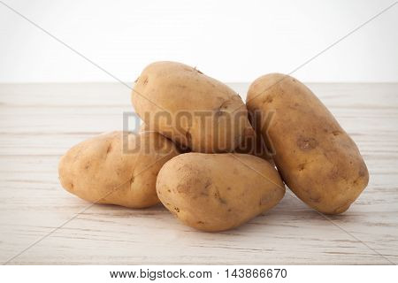 Potato Still Life On Wood Background