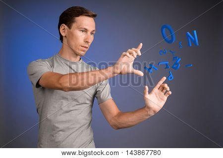 Man working with a set of letters, writing concept.